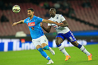 Miguel Britos challenged by  Stefano Okaka   during the Italian Serie A soccer match between   SSC Napoli and UC Sampdoria at San Paolo  Stadium in Naples ,April 26 , 2015