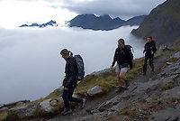 Neustift im Stubaital, Stubaier Hohenweg, Tirol, Austria, September 2008.  Four women hike down to the valley from the Neue Regensburger hutte. Hiking the Stubai High Trail from hut to hut in the southern Alps, we clear a mountain pass on a daily basis. Photo by Frits Meyst/Adventure4ever.com.