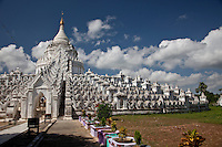 Hsinbyume Paya-seven whitewashed wavy terraces around the stupa represent the 7 mountain ranges around Mt Meru