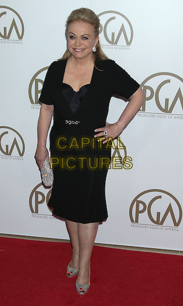Jacki Weaver.At the 24th Annual Producers Guild Awards held at the Beverly Hilton Hotel, Beverly Hills, California, USA,.26th January 2013..PGAs PGA arrivals full length black dress hand on hip silver shoes clutch bag.CAP/ADM/RE.©Russ Elliot/AdMedia/Capital Pictures.