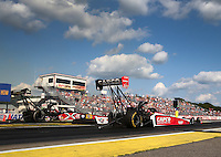 Aug 15, 2014; Brainerd, MN, USA; NHRA top fuel dragster driver Steve Torrence (right) races alongside Spencer Massey during qualifying for the Lucas Oil Nationals at Brainerd International Raceway. Mandatory Credit: Mark J. Rebilas-