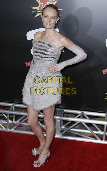 "KATE BOSWORTH, wearing Chanel Couture.The Premiere of Columbia Pictures ""21"" held at Planet Hollywood Hotel and Casino, Las Vegas, Nevada, USA,.12 March 2008..full length silver grey strapless ruffle dress arm warmers gloves hand on hip.CAP/ADM/MJT.©MJT/Admedia/Capital PIctures"