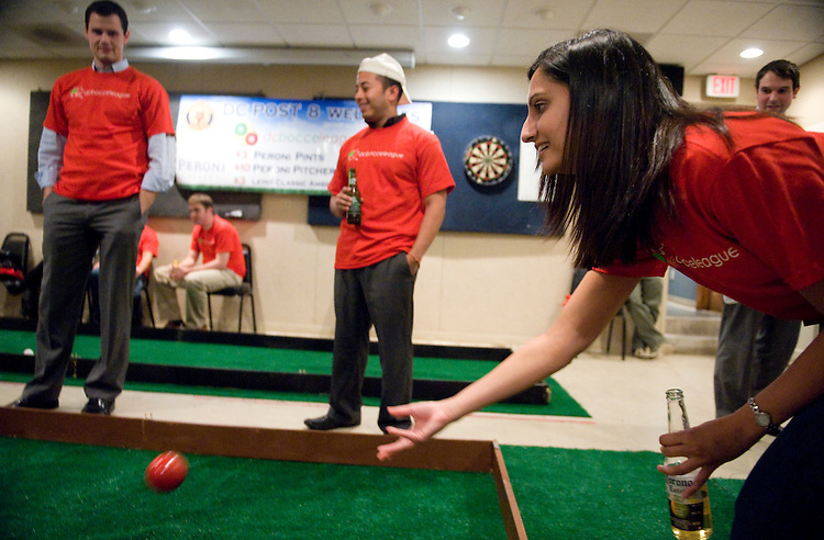 Kinnery Ardeshna of team Bocce Ballerz makes a throw during indoor bocce ball competition at the American Legion on Capitol Hill, Oct. 21, 2009.