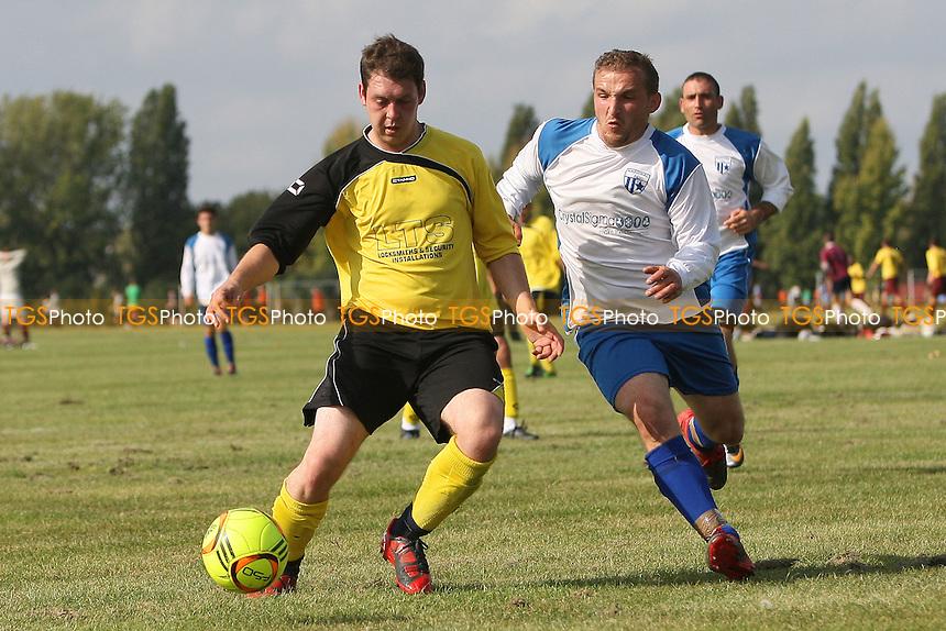 FC National (white) vs FC Polit (yellow) - Hackney & Leyton Sunday League Football at South Marsh, Hackney Marshes, London - 25/09/11 - MANDATORY CREDIT: Gavin Ellis/TGSPHOTO - Self billing applies where appropriate - 0845 094 6026 - contact@tgsphoto.co.uk - NO UNPAID USE.