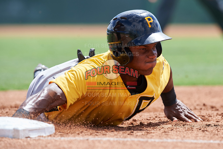 Pittsburgh Pirates Jeremias Portorreal (93) dives back to first base during an Instructional League Intrasquad Black & Gold game on September 28, 2016 at Pirate City in Bradenton, Florida.  (Mike Janes/Four Seam Images)