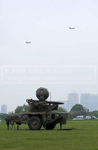 02/05/2012. LONDON, UK. RAF Chinook helicopters are seen beyond a Rapier air defence missile system of Sphinx Battery, 16 Regiment Royal Artillery, on Blackheath in London today (02/04/12). As part of an exercise testing military procedures and security across London for the 2012 Olympic Games a Rapier Surface to Air Missile System (SAM) has been deployed to Blackheath in South East London. Photo credit: Matt Cetti-Roberts