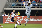 09 February 2012: Sydney Leroux (USA) (14) scores a goal over Gemma Fay (SCO) (1). The United States Women's National Team played the Scotland Women's National Team at EverBank Field in Jacksonville, Florida in a women's international friendly soccer match. The U.S. won the game 4-1.