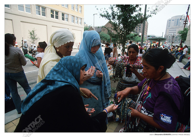 Mexican American Muslims conversts at a Cinco de Mayo parade (the old women are from Oaxaca, Mexico); Houston, Texas, May 2002.