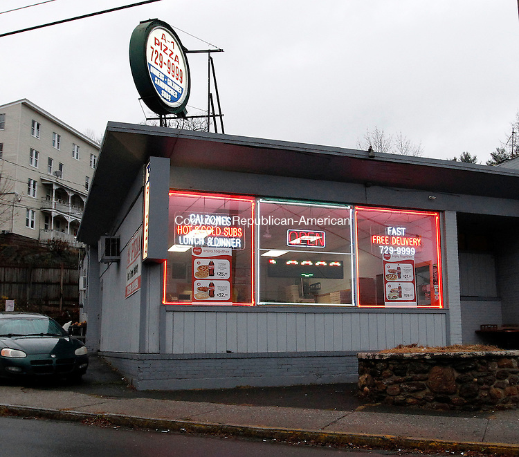 Naugatuck, CT-10 December 2012-121012CM15-  The front of A-1 Pizza is adorned with neon lights Monday afternoon in Naugatuck.  Flashing signs are allowed in town, who has begun sending out letters telling business owners to remove them.   Christopher Massa Republican-American