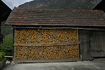 Chopped wood for winter fuel stored undercover, Imst district, Tyrol, Austria