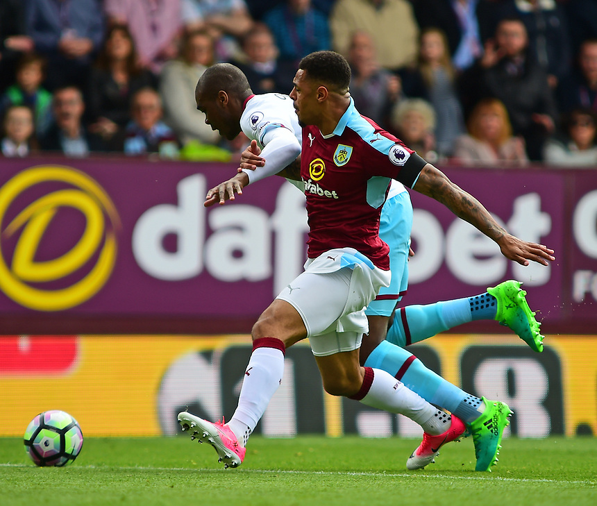 Burnley's Andre Gray is fouled by West Ham United's Angelo Ogbonna Obinze<br /> <br /> Photographer Andrew Vaughan/CameraSport<br /> <br /> The Premier League - Burnley v West Ham United - Sunday 21st May 2017 - Turf Moor - Burnley<br /> <br /> World Copyright &copy; 2017 CameraSport. All rights reserved. 43 Linden Ave. Countesthorpe. Leicester. England. LE8 5PG - Tel: +44 (0) 116 277 4147 - admin@camerasport.com - www.camerasport.com