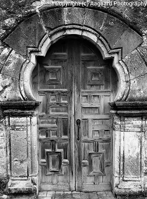 Doorway to Mission Espada, San Antonio, Texas.  Various theories exist for the unusual shape of the door, ranging from deliberate copying of a Moorish design to a mistake made by the stone mason.<br /> <br /> Mamiya RB67 Pro SD, 180mm lens, Kodak TMAX 100 film