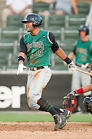 Chris Dominguez #19 of the Augusta GreenJackets follows through on his swing against the Kannapolis Intimidators at Fieldcrest Cannon Stadium June 24, 2010, in Kannapolis, North Carolina.  Photo by Brian Westerholt / Four Seam Images