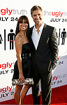 """HOLLYWOOD, CA. - July 16: Roselyn Sanchez and Eric Winter  arrive at the Los Angeles premiere of """"The Ugly Truth"""" held at the Pacific's Cinerama Dome on July 16, 2009 in Hollywood, California."""