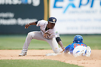 Kane County Cougars shortstop Jasrado Chisholm (3) tags Yeiler Peguero (20) out attempting to steal second base during a game against the South Bend Cubs on May 3, 2017 at Four Winds Field in South Bend, Indiana.  South Bend defeated Kane County 6-2.  (Mike Janes/Four Seam Images)