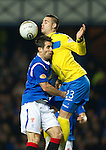 Rangers v St Johnstone...19.11.11   Scottish Premier League.Marcus Haber collides with Carlos Bocanegra.Picture by Graeme Hart..Copyright Perthshire Picture Agency.Tel: 01738 623350  Mobile: 07990 594431