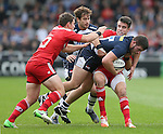 Marc Jones of Sale Sharks tackled by Conor Murray of Munster as Danny Cipriani of Sale Sharks waits in support - European Rugby Champions Cup - Sale Sharks vs Munster -  AJ Bell Stadium - Salford- England - 18th October 2014  - Picture Simon Bellis/Sportimage