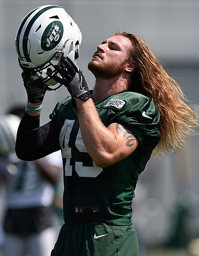 Dylan Donahue #49 of the New York Jets puts on his helmet during Training Camp at the Atlantic Health Jets Training Center in Florham Park, NJ on Saturday, Aug. 18, 2018.