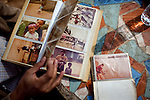 Pornlert Prompanya, 32, looks through old family photographs remembering what the Mekong River used to look like in Sop Ruak, Thailand. Photo taken on Wednesday, December 9, 2009. Kevin German / Luceo Images