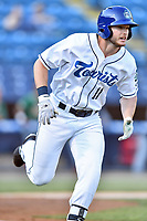 Asheville Tourists left fielder Casey Golden (11) runs to first base during a game against the Greensboro Grasshoppers at McCormick Field on May 10, 2018 in Asheville, North Carolina. The Tourists defeated the Grasshoppers 14-10. (Tony Farlow/Four Seam Images)