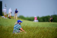 A Marshall sits in the deep fescue grass awaiting the next grouping of players to pass during the Wednesday practice day of the 117th U.S. Open, at Erin Hills, Erin, Wisconsin. 6/14/2017.<br /> Picture: Golffile | Ken Murray<br /> <br /> <br /> All photo usage must carry mandatory copyright credit (&copy; Golffile | Ken Murray)