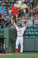 Center fielder Andrew Benintendi (2) of the Greenville Drive stretches in the on-deck circle in a game against the Greensboro Grasshoppers on Thursday, August 27, 2015, at Fluor Field at the West End in Greenville, South Carolina. Benintendi is a first-round pick of the Boston Red Sox in the 2015 First-Year Player Draft out of the University of Arkansas. Greenville won, 10-2. (Tom Priddy/Four Seam Images)