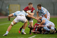 20121020 Copyright onEdition 2012©.Free for editorial use image, please credit: onEdition..Chris Ashton of Saracens is tackled by Antoine Battut of Racing Metro 92 during the Heineken Cup Round 2 match between Saracens and Racing Metro 92 at the King Baudouin Stadium, Brussels on Saturday 20th October 2012 (Photo by Rob Munro)..For press contacts contact: Sam Feasey at brandRapport on M: +44 (0)7717 757114 E: SFeasey@brand-rapport.com..If you require a higher resolution image or you have any other onEdition photographic enquiries, please contact onEdition on 0845 900 2 900 or email info@onEdition.com.This image is copyright the onEdition 2012©..This image has been supplied by onEdition and must be credited onEdition. The author is asserting his full Moral rights in relation to the publication of this image. Rights for onward transmission of any image or file is not granted or implied. Changing or deleting Copyright information is illegal as specified in the Copyright, Design and Patents Act 1988. If you are in any way unsure of your right to publish this image please contact onEdition on 0845 900 2 900 or email info@onEdition.com