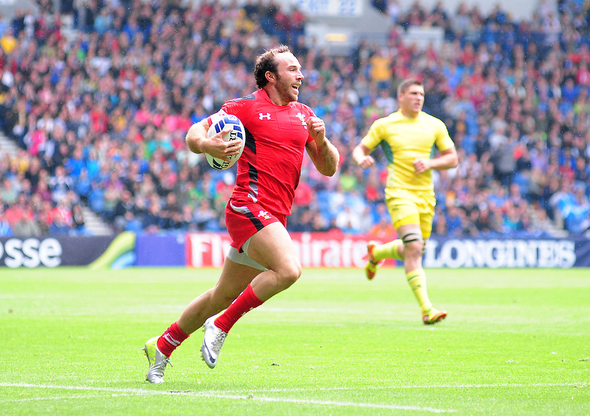 Wales's William Harries runs in his sides first try of the game<br /> <br /> Australia Vs Wales - Men's quarter-final<br /> <br /> Photographer Chris Vaughan/CameraSport<br /> <br /> 20th Commonwealth Games - Day 4 - Sunday 27th July 2014 - Rugby Sevens - Ibrox Stadium - Glasgow - UK<br /> <br /> &copy; CameraSport - 43 Linden Ave. Countesthorpe. Leicester. England. LE8 5PG - Tel: +44 (0) 116 277 4147 - admin@camerasport.com - www.camerasport.com