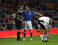 Ian Black argues with referee Stevie O'Reilly in the Rangers v Queen of the South Quarter Final match in the Ramsdens Cup played at Ibrox Stadium, Glasgow on 18.9.12.