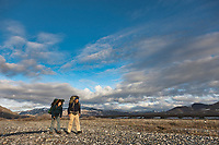 Author jordon fisher smith and son hike on the kongakut river drainage, Arctic National Wildlife Refuge, Brooks Range, Alaska.