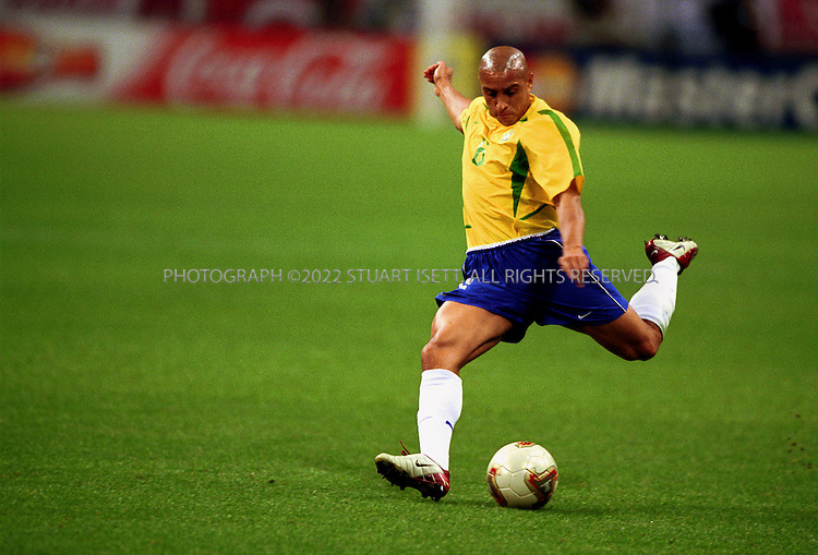 6/27/2002--Saitama, Japan..Brazil's #6, Carlos Roberto, blasts a shot at Turkey's goal in the 13th minute of the first half. Brazil beat Turkey 1-0, with a second half goal by Ronaldo, and will face Germnay ion the final in Yokohama this Sunday, June 30th...All photographs ©2003 Stuart Isett.All rights reserved.This image may not be reproduced without expressed written permission from Stuart Isett.