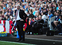 Stoke City manager Mark Hughes shouts instructions to his team from the dug-out<br /> <br /> Photographer Kevin Barnes/CameraSport<br /> <br /> The Premier League - Swansea City v Stoke City - Saturday 22nd April 2017 - Liberty Stadium - Swansea<br /> <br /> World Copyright &copy; 2017 CameraSport. All rights reserved. 43 Linden Ave. Countesthorpe. Leicester. England. LE8 5PG - Tel: +44 (0) 116 277 4147 - admin@camerasport.com - www.camerasport.com