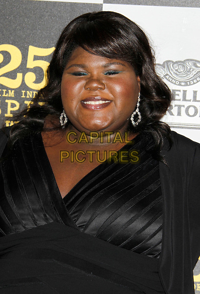 "GABOUREY ""GABBY"" SIDIBE.25th Annual Film Independent Spirit Awards - Arrivals held at the Nokia Event Deck at L.A. Live, Los Angeles, California, USA, 5th March 2010..indie portrait headshot black dangly earrings silver .CAP/ADM/MJ.©Michael Jade/AdMedia/Capital Pictures."