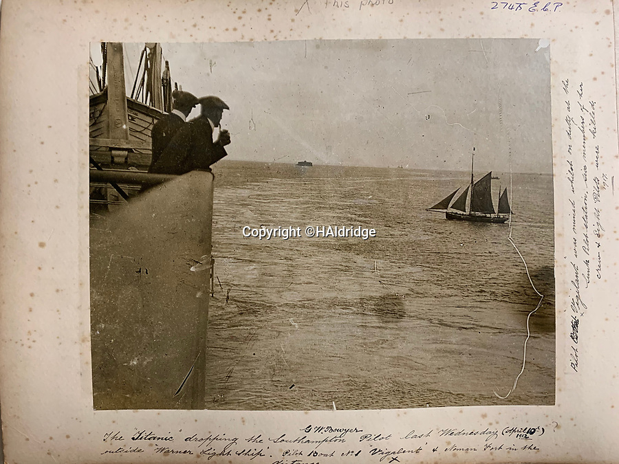 BNPS.co.uk (01202 558833)<br /> Pic: HAldridge/BNPS<br /> <br /> Main Picture: In the immediate foreground are two male passengers of the Titanic looking out to the Isle of Wight.<br /> <br /> An incredibly rare photograph that was taken on board the Titanic while the liner was on he doomed maiden voyage has surfaced.The poignant image was taken by a first class passenger who was stood on the boat deck as Titanic crossed the Solent about an hour after slipping its mooring.Father Francis Browne leant over the railing to capture the pilot boat leaving Titanic for the last time having picked up harbour pilot George Bowyer.Mr Bowyer had just manoeuvred the 46,000 tonne ship out of congested Southampton Water and into the Solent on April 10, 1912.