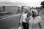 Derry Northern Ireland Londonderry. 1979.Two protestant women look down to where their homes in Catholic Derry used to be. They have been moved out due to sectarian violence.