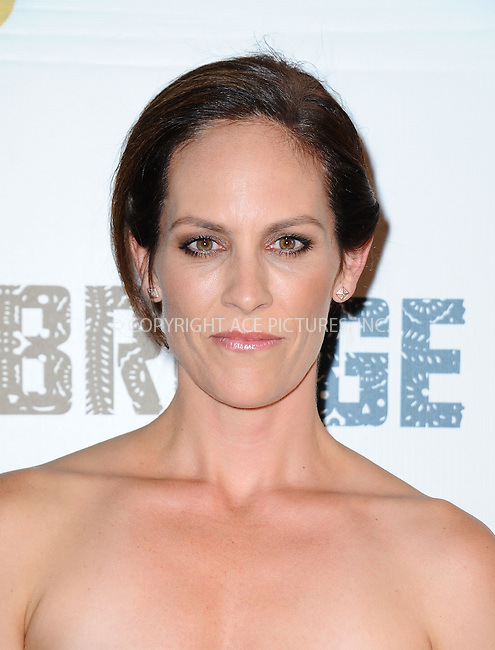 WWW.ACEPIXS.COM<br /> <br /> July 8 2013, LA<br /> <br /> Annabeth Gish arriving at the series premiere of FX's 'The Bridge' at DGA Theater on July 8, 2013 in Los Angeles, California. <br /> <br /> By Line: Peter West/ACE Pictures<br /> <br /> <br /> ACE Pictures, Inc.<br /> tel: 646 769 0430<br /> Email: info@acepixs.com<br /> www.acepixs.com