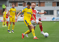 AFC Wimbledon's Callum Reilly under pressure from Fleetwood Town's Paddy Madden<br /> <br /> Photographer Kevin Barnes/CameraSport<br /> <br /> The EFL Sky Bet Championship - Fleetwood Town v AFC Wimbledon - Saturday 10th August 2019 - Highbury Stadium - Fleetwood<br /> <br /> World Copyright © 2019 CameraSport. All rights reserved. 43 Linden Ave. Countesthorpe. Leicester. England. LE8 5PG - Tel: +44 (0) 116 277 4147 - admin@camerasport.com - www.camerasport.com