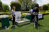 United States President Barack Obama tries the bicycle-powered emergency water-sanitation station, created and presented by high schoolers Payton Karr (L) and Kiona Elliot (R) from Oakland Park, Florida, in the East Garden of the White House in Washington, D.C., during the White House Science Fair on April 22, 2013. The White House Science Fair celebrates the student winners of a broad range of science, technology, engineering and math (STEM) competitions from across the country. The first White House Science Fair was held in late 2010.<br /> Credit: Aude Guerrucci / Pool via CNP