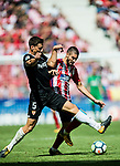 Yannick Ferreira Carrasco (r) of Atletico de Madrid battles for the ball with Clement Nicolas Laurent Lenglet of Sevilla FC  during the La Liga 2017-18 match between Atletico de Madrid and Sevilla FC at the Wanda Metropolitano on 23 September 2017 in Madrid, Spain. Photo by Diego Gonzalez / Power Sport Images