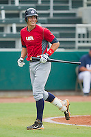 Nicky Delmonico #54 of Team Red jogs smirks after having been called out on strikes against Team Blue during the USA Baseball 18U National Team Trials at the USA Baseball National Training Center on June 30, 2010, in Cary, North Carolina.  Photo by Brian Westerholt / Four Seam Images
