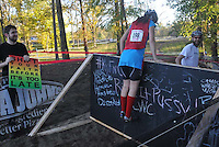 The organizers designed a novel, challenging course. Here racers practiced hurdling the 4 foot tall blackboard barrier.