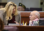 Nevada Assembly Republicans Michele Fiore and Jim Wheeler talk on the Assembly floor at the Legislative Building in Carson City, Nev., on Sunday, May 31, 2015.  <br /> Photo by Cathleen Allison