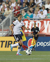 USWNT midfielder Carli Lloyd (10) brings the ball forward.  In an international friendly, the U.S. Women's National Team (USWNT) (white/blue) defeated Korea Republic (South Korea) (red/blue), 4-1, at Gillette Stadium on June 15, 2013.