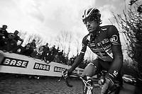 De Ronde van Vlaanderen 2012..Fabian Cancellara up the Molenberg as 1 of teh last riders after a mechanical at the bottom of the climb