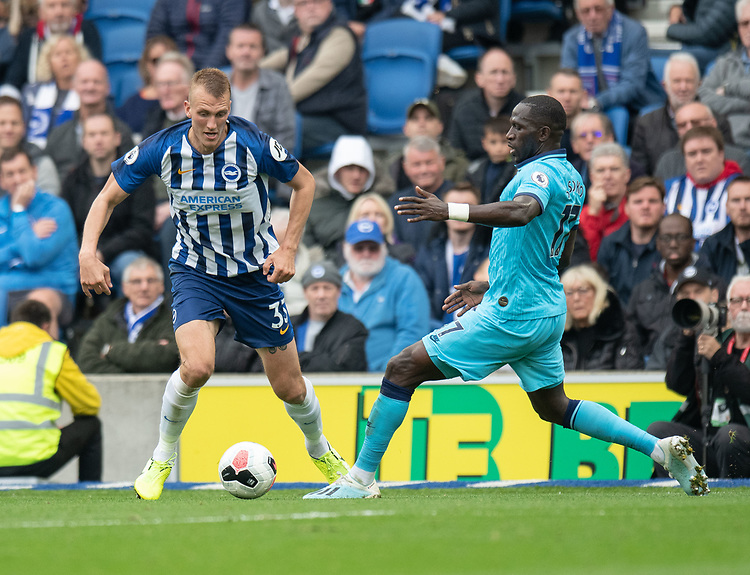 Brighton & Hove Albion's Dan Burn (left) under pressure from Tottenham Hotspur's Moussa Sissoko (right) <br /> <br /> Photographer David Horton/CameraSport<br /> <br /> The Premier League - Brighton and Hove Albion v Tottenham Hotspur - Saturday 5th October 2019 - The Amex Stadium - Brighton<br /> <br /> World Copyright © 2019 CameraSport. All rights reserved. 43 Linden Ave. Countesthorpe. Leicester. England. LE8 5PG - Tel: +44 (0) 116 277 4147 - admin@camerasport.com - www.camerasport.com