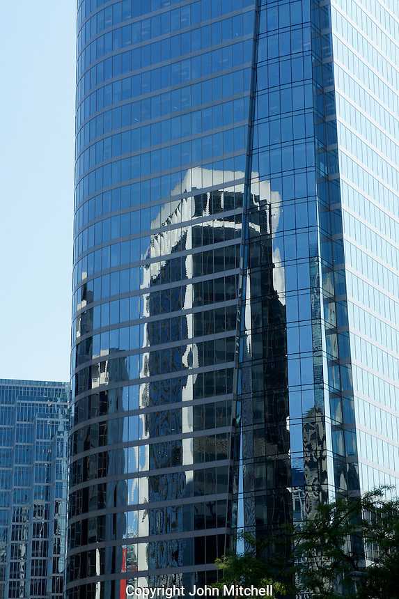 Building reflected in a the Bell glass skyscraper Sightseeing in Vancouver, British Columbia, Canada