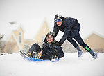 Max Montwill and Jack Joyce having fun in the snow at Woodstock View in Ennis. Photograph by John Kelly.