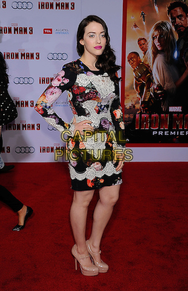 """Kat Dennings.The Los Angeles Premiere of """"Iron Man 3"""" at El Capitan Theatre in Hollywood, California, USA..April 24th, 2013.full length black white red orange floral print lace dress beige shoes platform hand on hip.CAP/ROT/TM.©Tony Michaels/Roth Stock/Capital Pictures"""