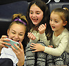 Matison Kindelmann, 6, center, and sister Charlotte Kindelmann, 4, have fun taking 'selfies' with Cold Spring Harbor gymnast Skylar Basso during the eight-team Cartwheel for a Cure gymnastics meet at Cold Spring Harbor High School on Monday, Jan. 16, 2017. The sisters were born with cystic fibrosis. Their mother, Teri Kindelmann, is the school's gymnastics head coach.