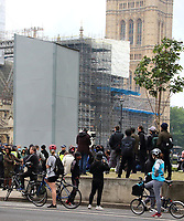 Police Presence at boarded up Sir Winston Churchill statue in Westminster.<br /> Several of London's historic statues have been boarded up to protect them from being defaced or damaged during this weekend's expected protests in the capital. London, UK June 12th 2020<br /> <br /> Photo by Keith Mayhew